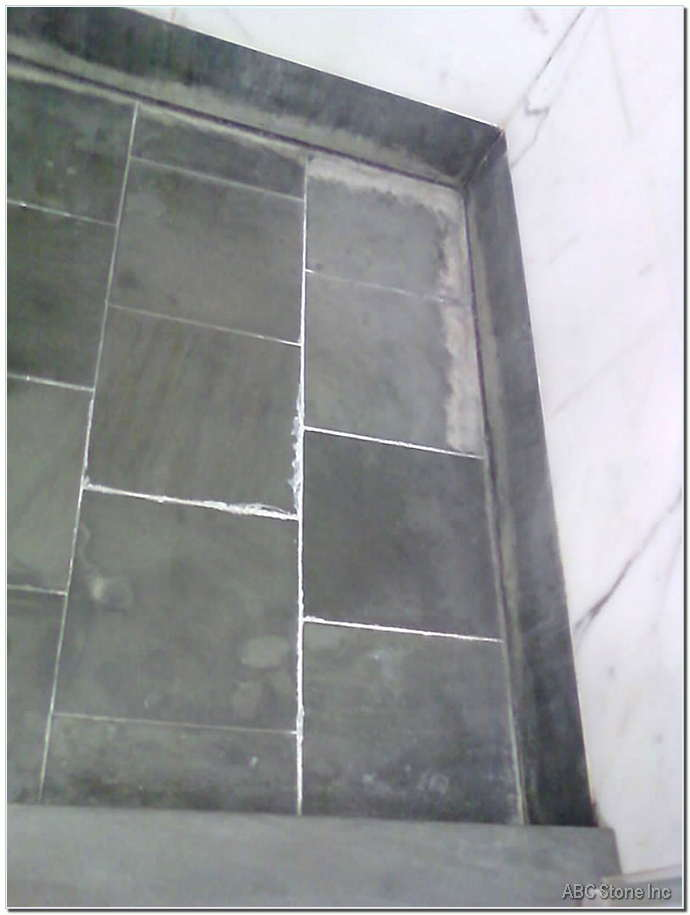 Marble Shower Floor. Water Deposits